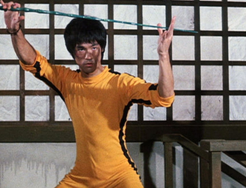 Bruce Lee wearing yellow jumpsuit he designed